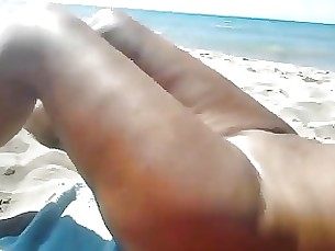 mature playing beach blowjob
