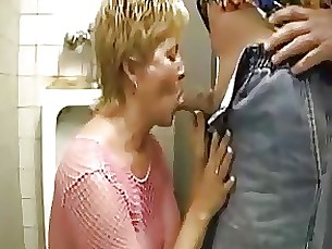mature cumshot blowjob blonde toilet public oil